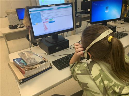 A Williamston Middle School student engages in a coding lesson