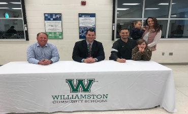 Mr. Paige Paulsen signs as the District's AD and Enrichment Director, FEB 2020